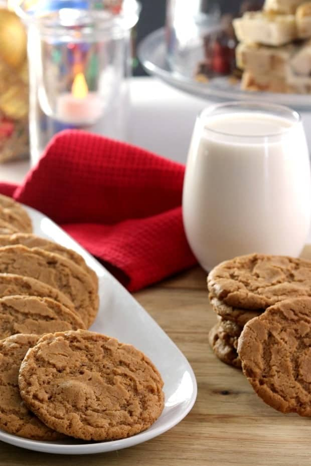 A plate of gingersnap cookies with milk.