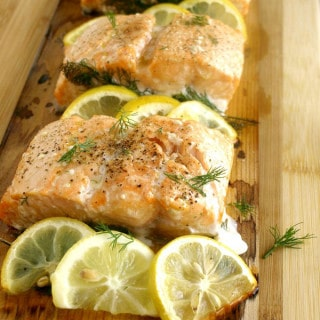 Cedar Plank Salmon is a wonderfully smoky, lightly seasoned dish that is perfect for any backyard BBQ or even a date night meal. #BBQ #GRILL #SUMMER #FishRecipes #Salmon #CedarPlank #CedarWrap @KitchenDreaming