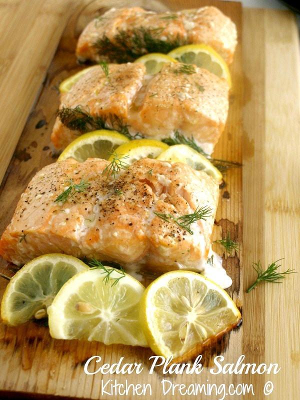 Cedar Plank Salmon is a wonderfully smoky, lightly seasoned dish that is perfect for any backyard BBQ or even a date night meal. #BBQ #GRILL #SUMMER #FishRecipes #Salmon #CedarPlank #CedarWrap @KitchenDreaming