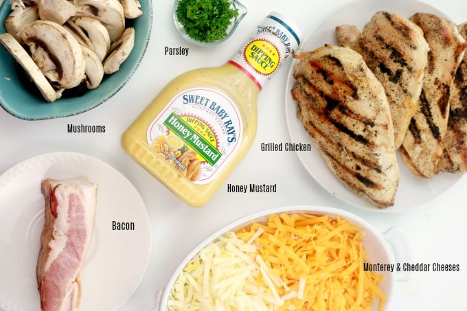 An image of the ingredients needed for ALice SPrings Chicken: bacon, mushrooms, parsley, grilled chicken, honey mustard sauce, monterey and cheddar cheeses.