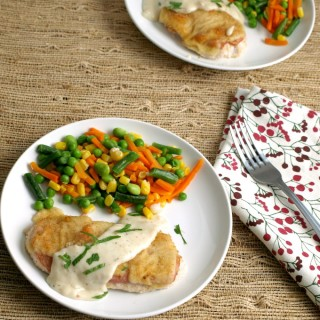 Oven Chicken Cordon Bleu chicken breasts are layered into a baking dish, topped with ham, cheese and bread crumbs then baked to a golden brown,