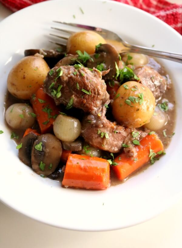 A close up photo of a bowl of beef burgundy.