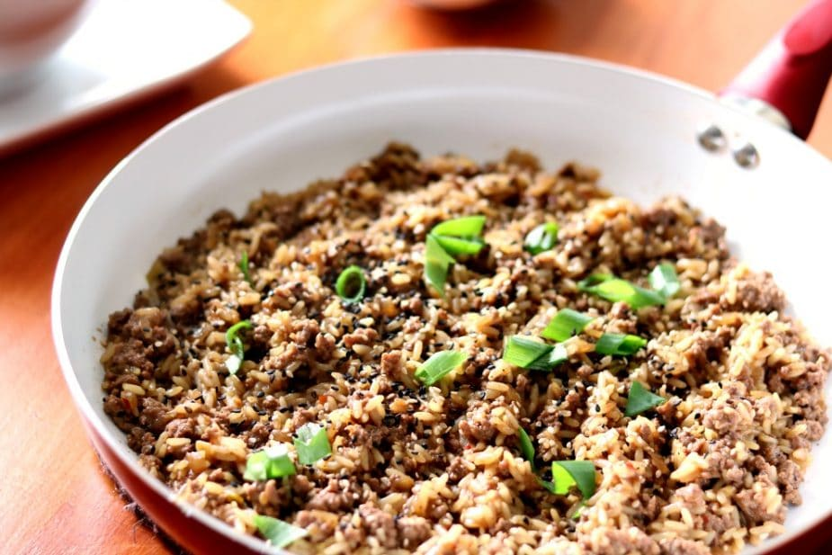 Korean Bulgogi Beef and Rice Skillet is flavorful and ready in the time it takes to simmer the rice in with the ground beef.