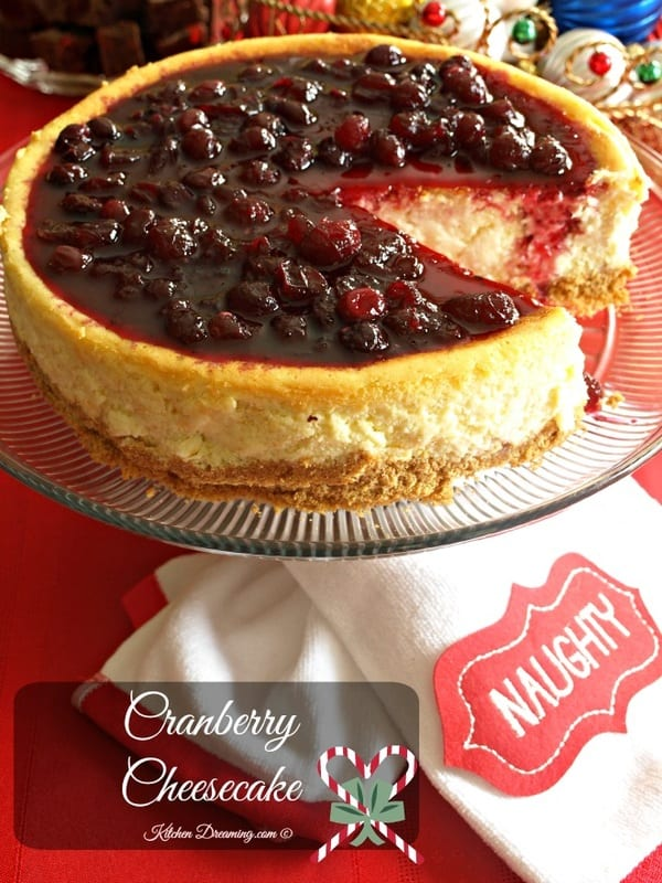 Cranberry cheesecake on a cake stand for serving.