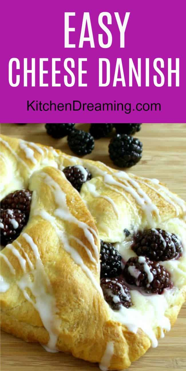 A breakfast pastry filled with cheese and fresh blackberries.