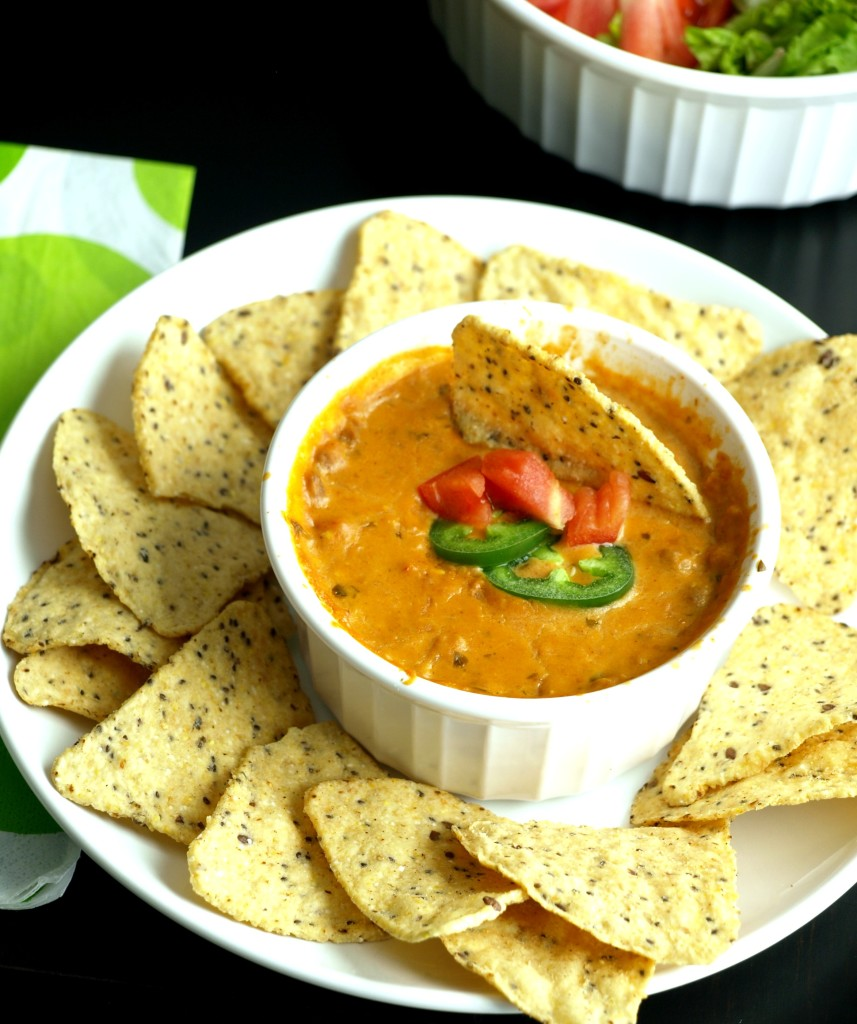 Crock Pot Nacho Dip: add a variety of different toppings & offer your own nacho bar for folks to customize any way they choose!