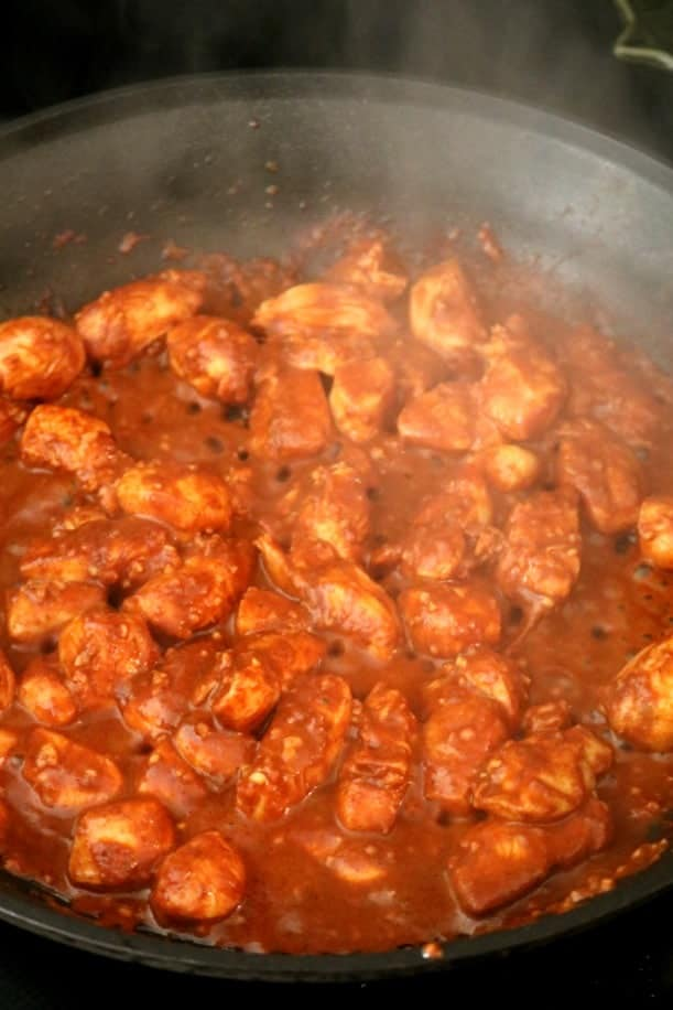 30 minute chicken vindaloo kitchen dreaming a skillet full of chicken vindaloo cooking on the stove top forumfinder Images