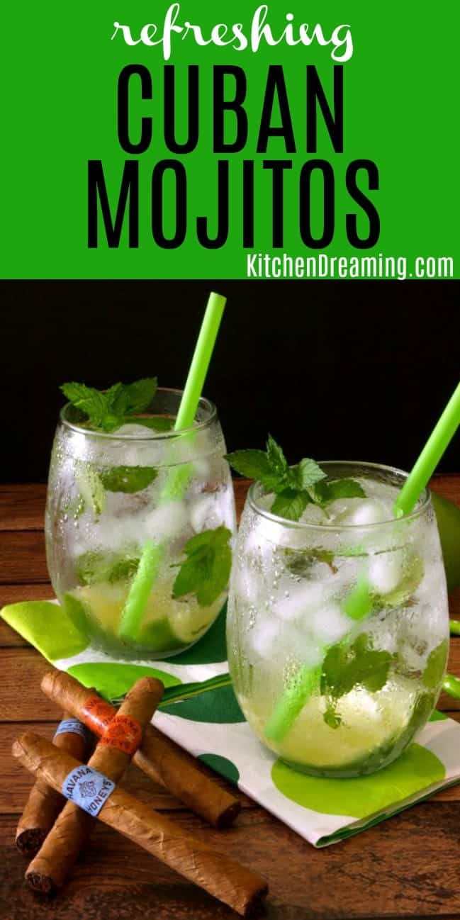Two Cuban Mojito cocktails in glasses garnished with fresh lime and mint with green straws.