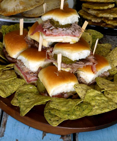 A tray of Cuban Sliders surrounded by chips
