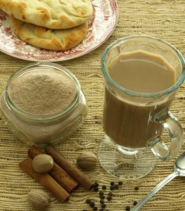 Instant Chai Latte Mix with a cup of chai.
