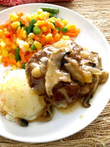 "Let this one-skillet Salisbury Steak take a little of the ""hectic"" out of your day. It's ready in just about 30 minutes."