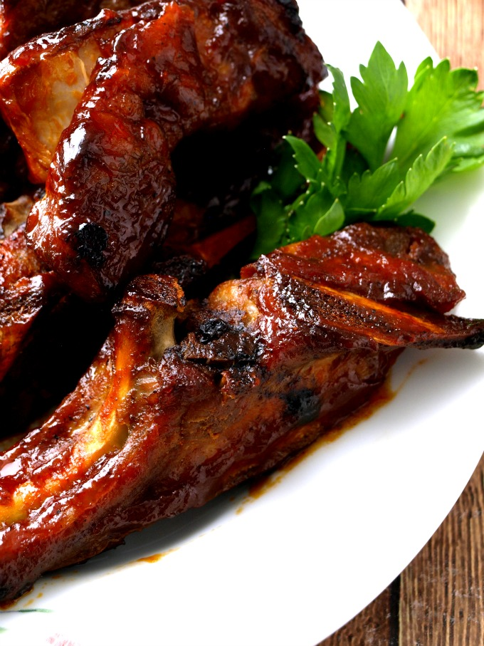 A close up image of a plate of oven-baked country-style pork ribs