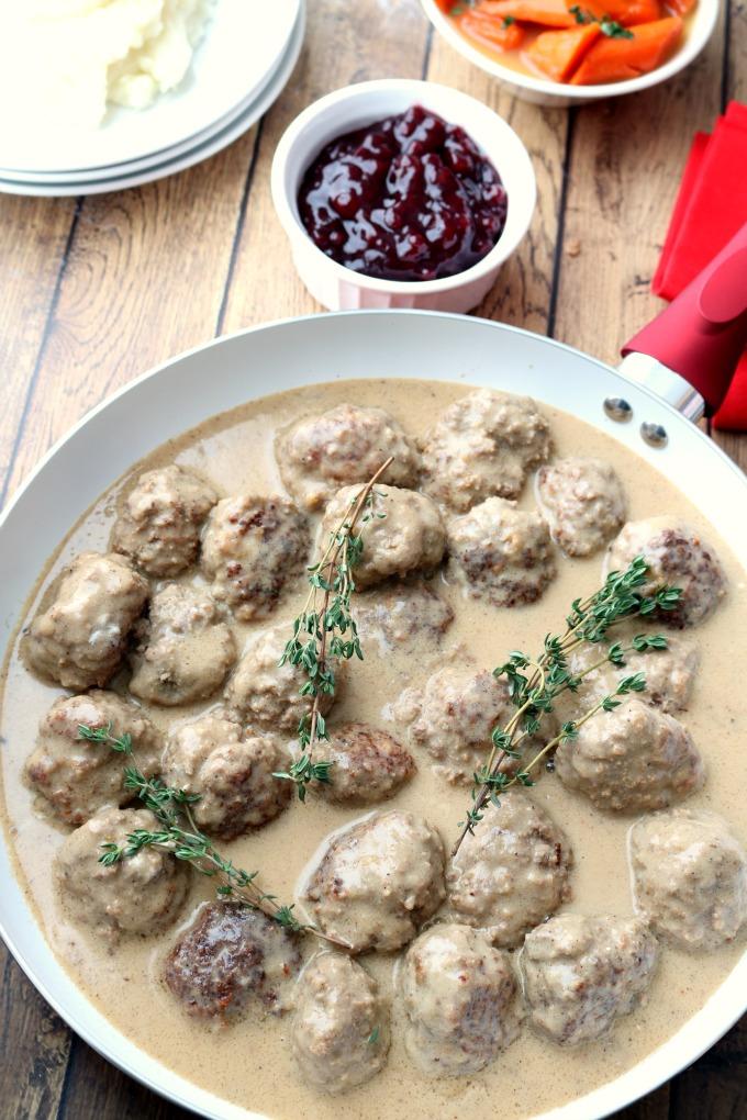 Wdw akershus royal banquet hall norwegian kjttkaker meatballs an overhead shot of a pan of norwegian meatballs topped with sprigs of fresh thyme forumfinder Gallery