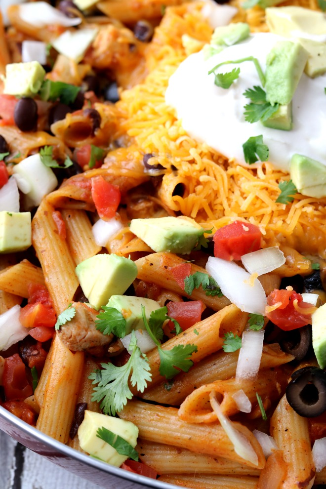Close-up View of Cooked Chicken, Pasta, Black Beans and Salsa topped with Sour Cream