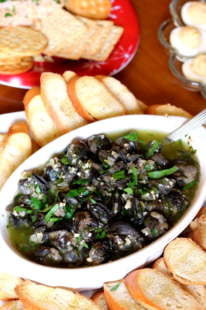 Escargots à la Bourguignonne are tender & delicious. Serve with a crusty baguette for sopping up the butter sauce & you have the perfect quick & easy app.