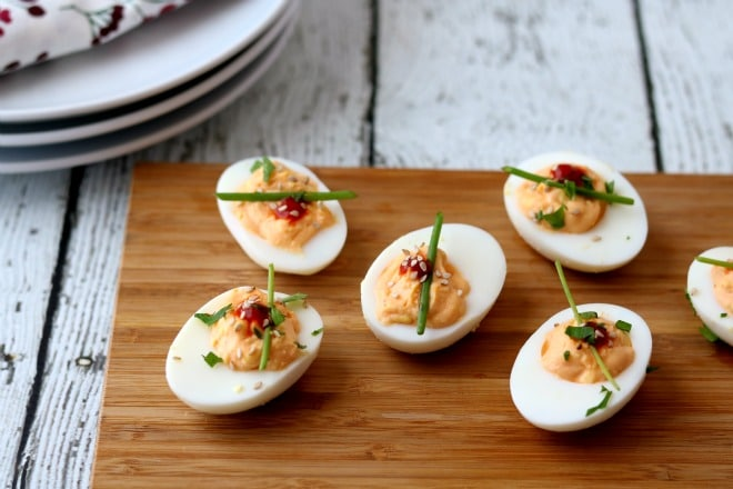 Looking for different ways to dress up deviled eggs to appease the spice lovers on your list? One simple way is with an Asian flair on this classic appetizer.