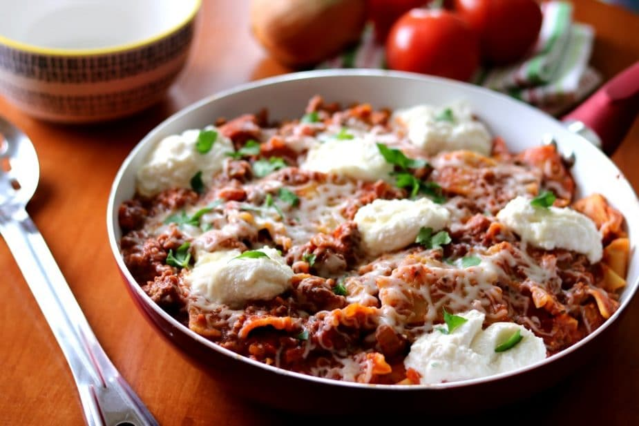 This 30-minute Skillet Lasagna tastes just like traditional lasagna without all the fuss of layering! Add this quick and simple dish into your weeknight dinner rotation and take your ordinary pasta night from ordinary to extraordinary!