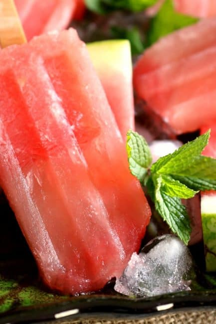 These Boozy Watermelon Margarita Popsicles are a hit at backyard parties and barbecues. Everyone LOVES popsicles, adults included, so why not make your favorite summer cocktail into a popsicle??