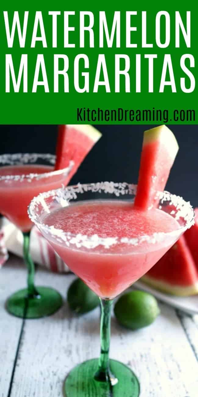 two glasses of watermelon margaritas garnished with fresh watermelon wedges and a salted rim.