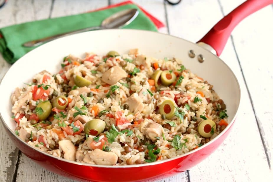 Bursting with flavor, this Puerto Rican version of Skillet Caribbean Chicken and Rice is easy to make and ready in just about 30 minutes.