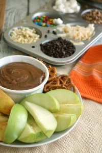 This DIY Caramel Apple Bar is the perfect way to enjoy dipped apples and are much easier to handle for kids and adults alike. For me, I enjoy the endless flavor combinations we can create