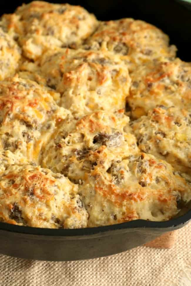 A close-up photo of a pan of baked loaded breakfast biscuits ready to be eaten.