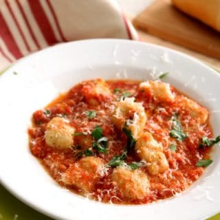 A simple fresh pomodoro tomato sauce over pillowy, soft gnocchi. Gnocchi in Pomodoro Sauce; it's what's for dinner. Yum.