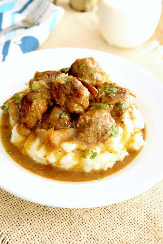 These Salisbury Steak Meatballs with Mushroom Gravy are classic comfort food. This incredibly delicious dinner recipe is ready in about 30-minutes! #Salisbury #Steak #Meatballs #Recipe #KitchenDreaming