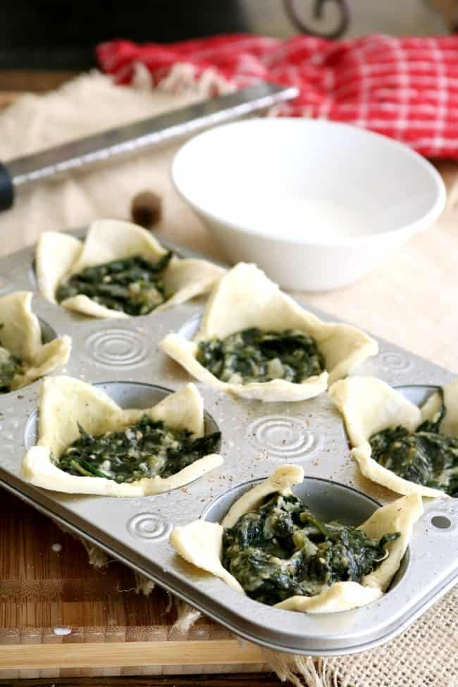 Spinach Puffs ready for the oven in muffin tins