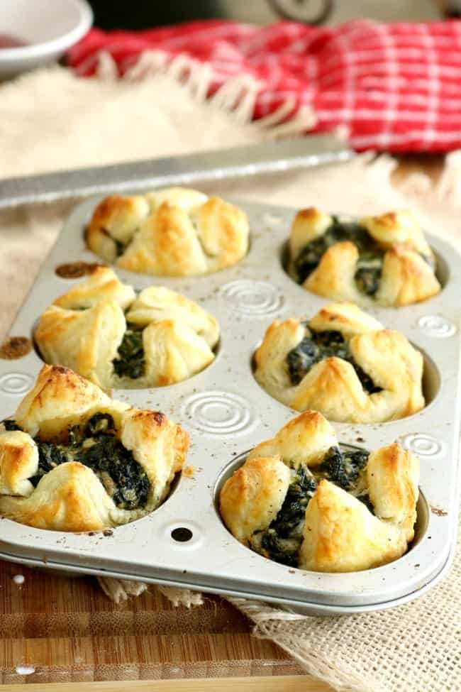 Spinach Puffs make an easy and elegant appetizer for Holiday entertaining. These can be prepared a day or two in advance and then baked off just before the party. Ready in just 12 minutes, these Spinach Puffs make entertaining easy!