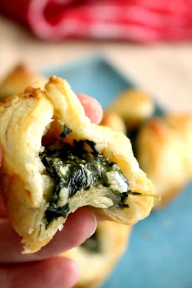 Spinach Puffs with a bite missing