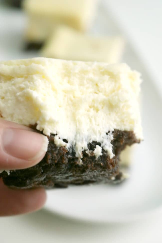 A closeup of a bite of cheesecake brownie creamy and moist center