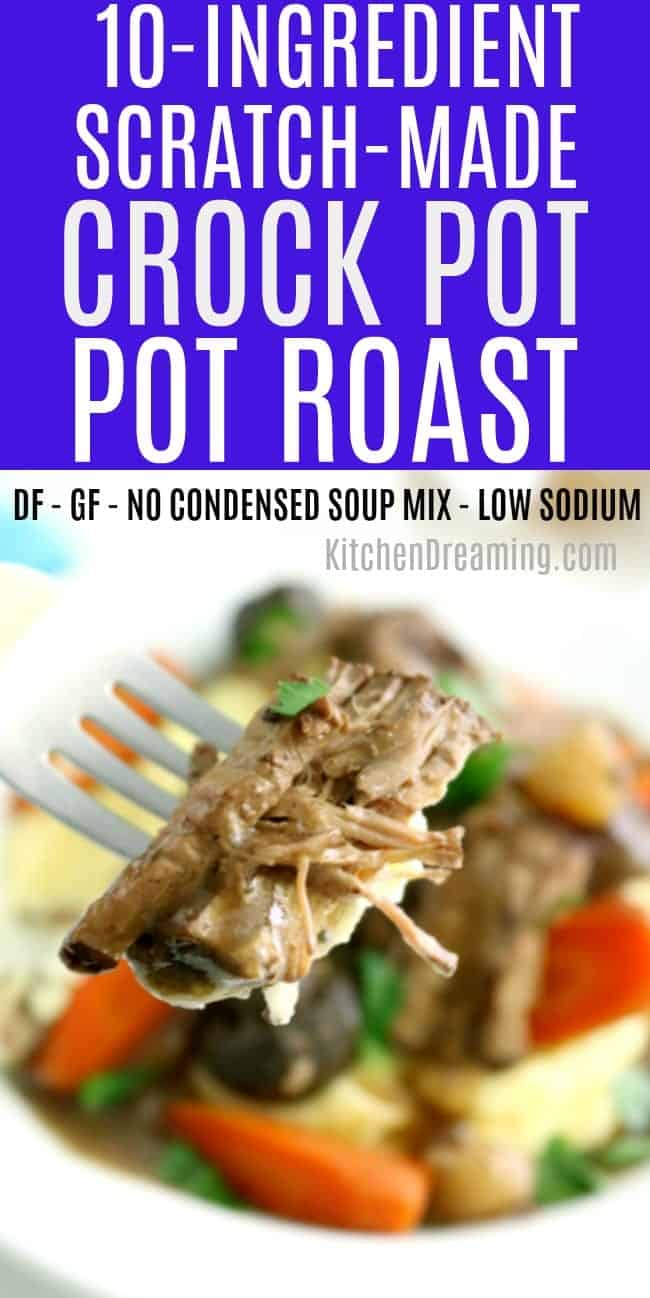 a fork full of tender pot roast in gravy with a bowl of pot roast, carrots, potatoes, and mushrooms in the background.