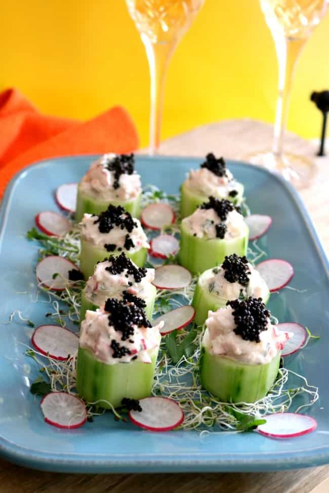 Wild Alaskan Snow crab salad is nestled into a refreshing cucumber cup and then topped with a dollop of caviar. The caviar tastes briny like the ocean which blends well into the bright flavors of the crab salad #AskForAlaska #IC #ad