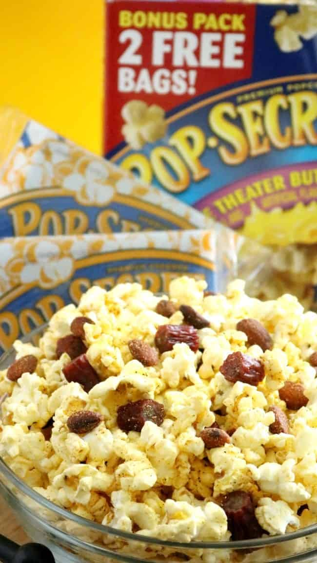 Spicy, buttered popcorn mixed with habanero spiced almonds and mini turkey sausage bites come together to create a popcorn mix worth of any man cave