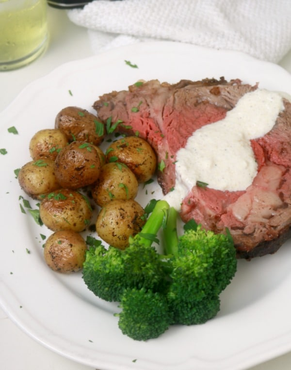 Prime Rib Roasted plated 3 quarter shot with horseradish sauce