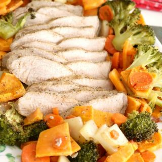 Tender and juicy marinated pork roasts in the oven with seasonal vegetables for a comforting, nutritious, and easy dinner! This Roasted Pork Tenderloin comes together with only 10 minutes of preparation!