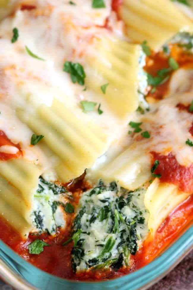 a CLOSE UP IMAGE OF A STUFFED MANICOTTI SHELLS