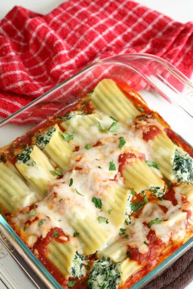 AN OVERHEAD SHOT OF A BAKED TRAY OF MANICOTTI