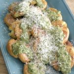 These Crispy Roasted Potatoes with Parmesan and Parsley Pesto make a great side dish, especially for a meat and potatoes type meal. To speed these up, you can steam them in the microwave, but today I've boiled them until tender and then crisped them up in the oven. The fresh herb pesto is great on seafood and chicken as well as these spunky little spuds.
