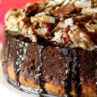 A close-up photo of the side and coconut-pecan topping of a German Chocolate cheesecake.