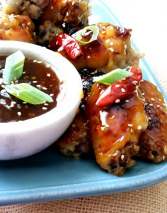 America's favorite sweet and spicy, General Tso's sauce smothering crispy, baked chicken wings! No extra breading, frying or fuss! Come on in and give these General Tso Chicken Wings a try.