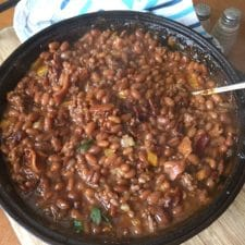 These Best Ever Meaty BBQ Baked Beans will be the hit of your backyard party or cookout this summer. Bring these to your next potluck - they are always a crowd favorite.