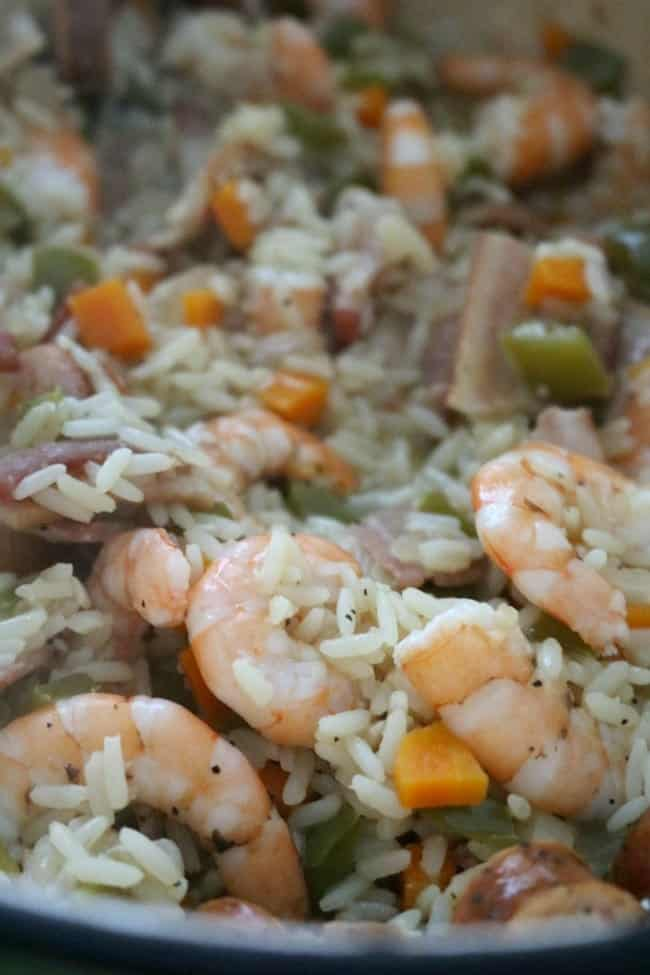 One-pot Lowcountry Shrimp Perloo is simple to make and rich in flavors and tradition. Shrimp Perloo is a rice dish made with locally grown rice and local, fresh shellfish. Similar to jambalaya and paella, perloo starts with a flavorful base of rice simmered with bell pepper, carrots, garlic, and onion.