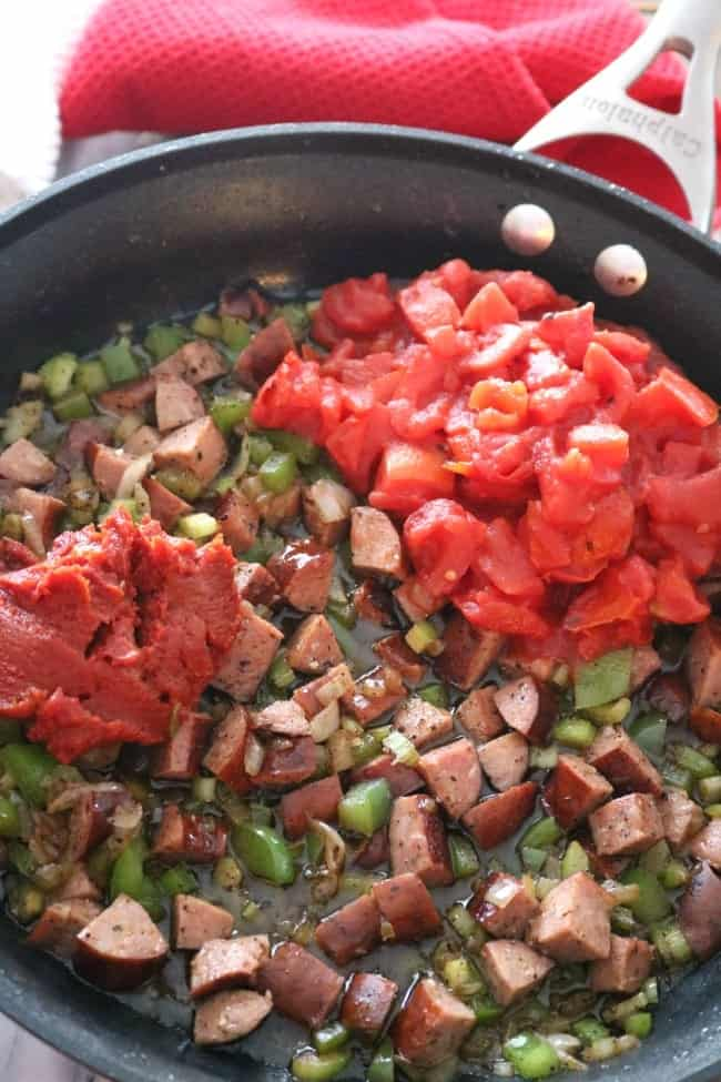 Red Rice and Sausage is a staple in the Southern United States, especially in the coastal areas of Charleston, SC, and Savannah, Ga. This span of low-lying coastal area is also known as the Lowcountry. Here in Charleston, red rice and sausage is a way of life. It's eaten with many different types of meals, but especially seafood. It's relatively easy to make but so flavorful.