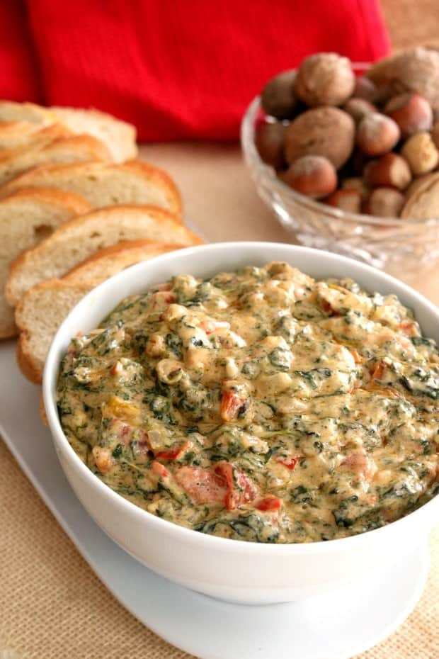 Hot and cheesy, gooey and melty, Hot Spinach Dip is the perfect appetizer. Ready to serve!