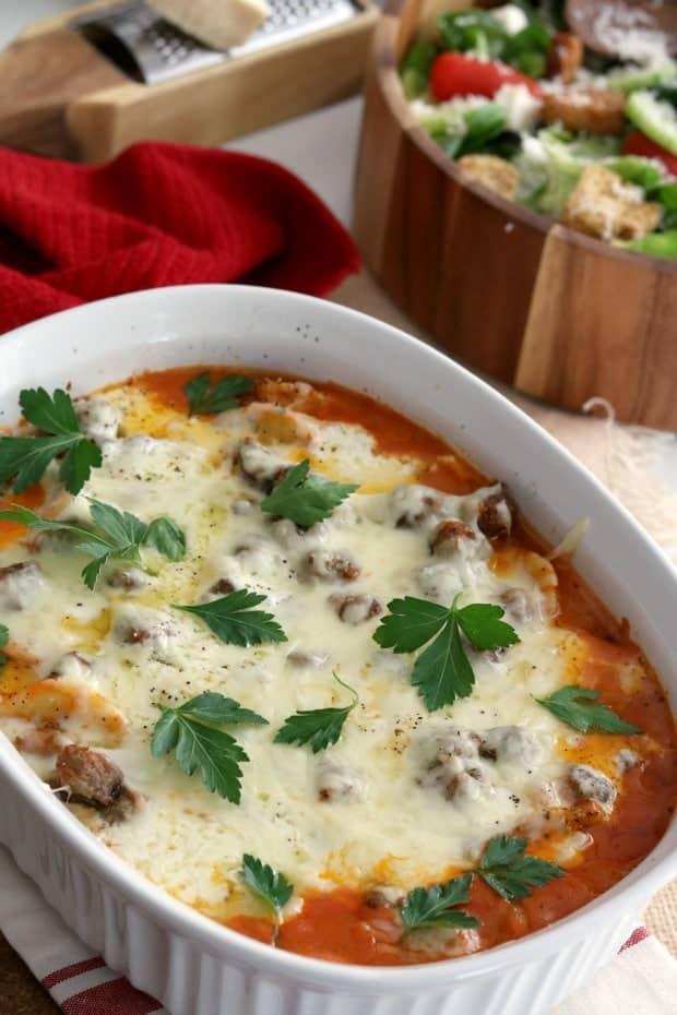 casserole of baked ravioli in rose sauce