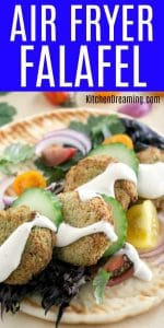 Air Fryer Falafel on pita bread topped with cucumbers, red onions, tomatoes, and tatziki sauce.