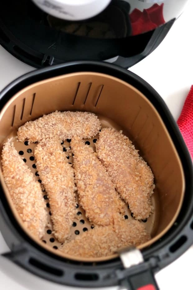 The fry basket filled with breaded Ranch Chicken Tenders getting ready for the Power Air Fryer XL.