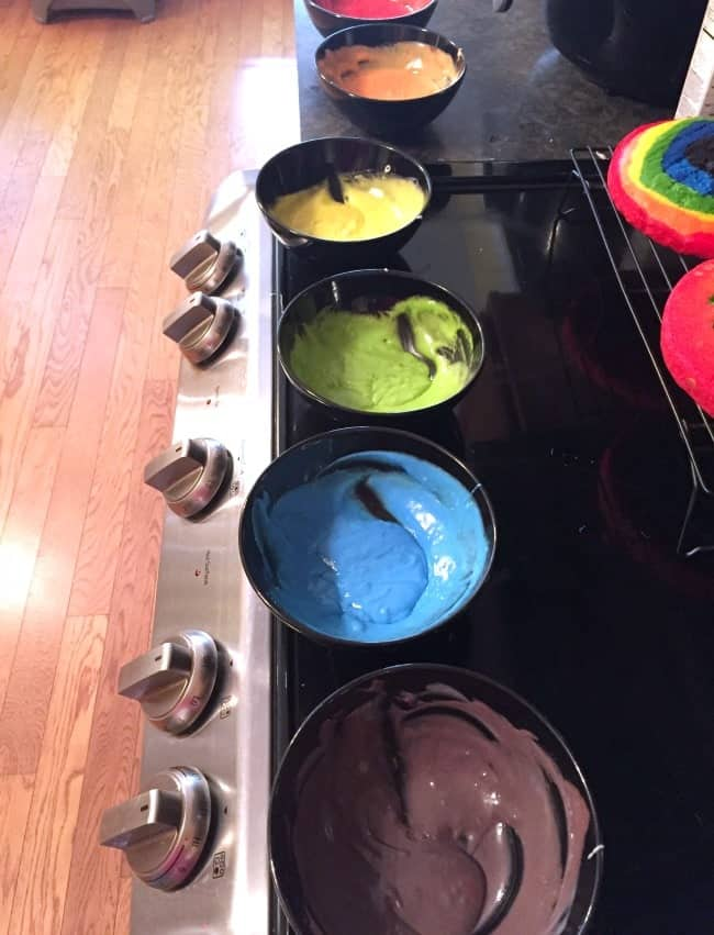making the colored batter for the mystical unicorn cake.